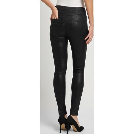 79b9a446a191 Woskowane spodnie skinny czarny Orsay 36 okazyjna cena orsay.com ...