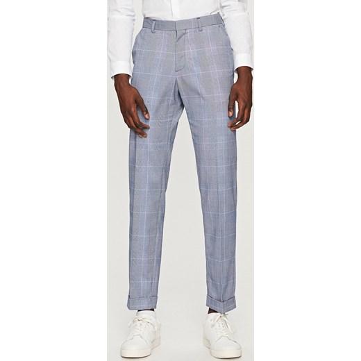 2430069988249 Reserved - Spodnie garniturowe w kratę Niebieski w Domodi