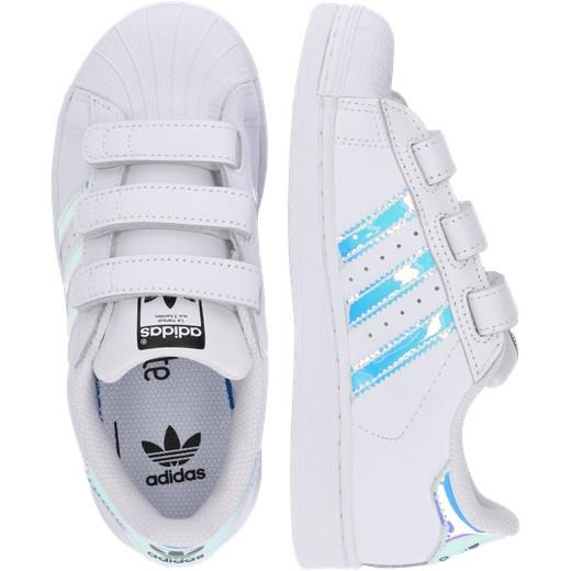 b5009e9983e37 Trampki dziecięce białe Adidas Originals bez wzorów na rzepy · Adidas  Originals trampki dziecięce na rzepy ...