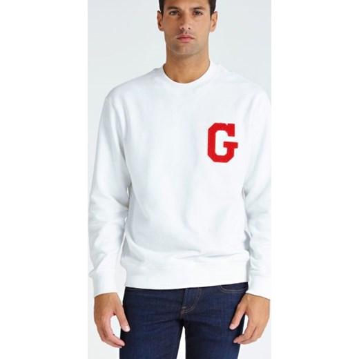2477e09f14834 Bluza męska biała Guess z nadrukami w stylu młodzieżowym w Domodi