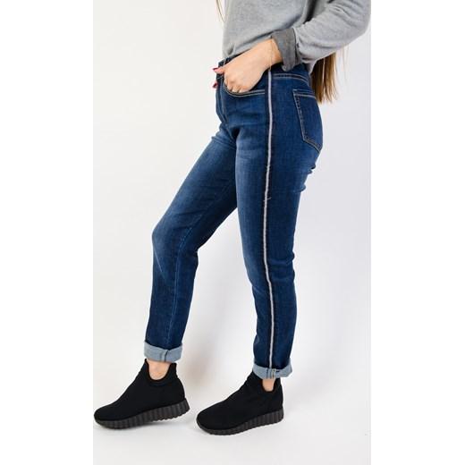 2d9f06a291 Granatowe jeansy damskie Olika jeansowe na jesień w Domodi