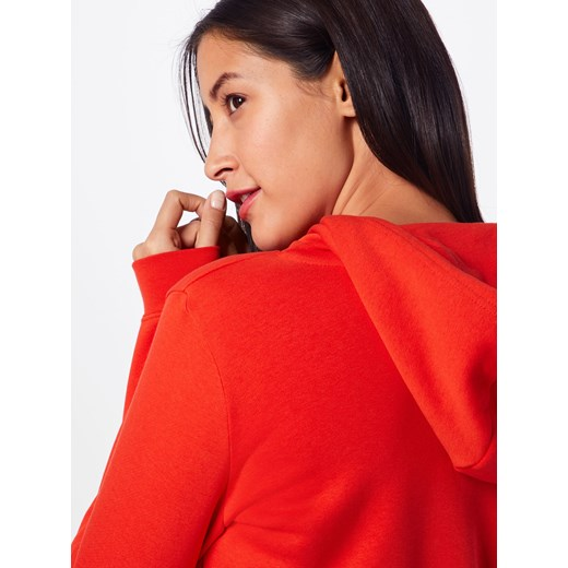 Bluza damska pomarańczowy Nike Sportswear z napisami w Domodi