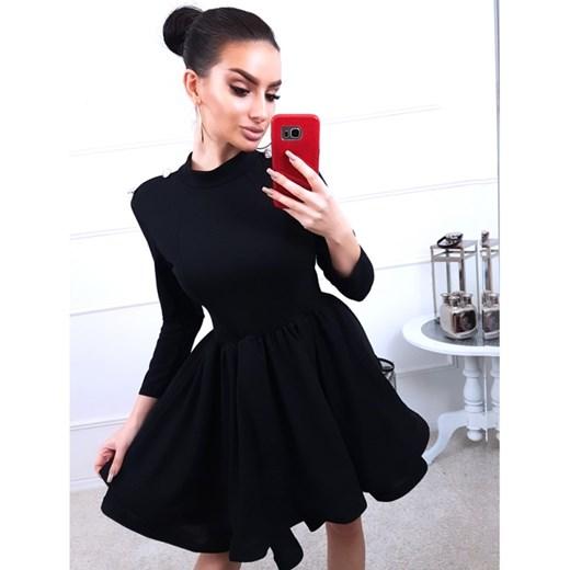 c5214b4998 Czarna sukienka Magmac w rockowym stylu z długimi rękawami rozkloszowana  bez wzorów mini z okrągłym dekoltem ...