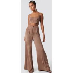 19dda623dd8ec Brązowe spodnie damskie, lato 2019 w Domodi