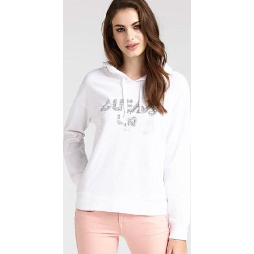 c8ab8581a2536 Bluza damska Guess biała z bawełny krótka w Domodi