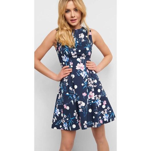 f2fac90428 Sukienka ORSAY na urodziny elegancka w kwiaty trapezowa w Domodi