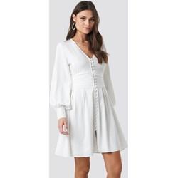 51338bf072 Sukienka NA-KD Boho z długim rękawem bez wzorów trapezowa