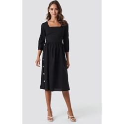 6282b1df4b Sukienka Trendyol bez wzorów z długim rękawem midi elegancka trapezowa