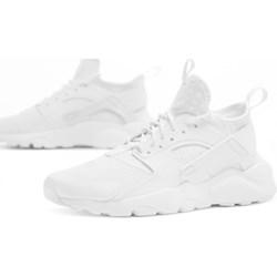 buy popular 0b332 c4f0c Białe buty sportowe damskie Nike do biegania huarache sznurowane na  płaskiej podeszwie