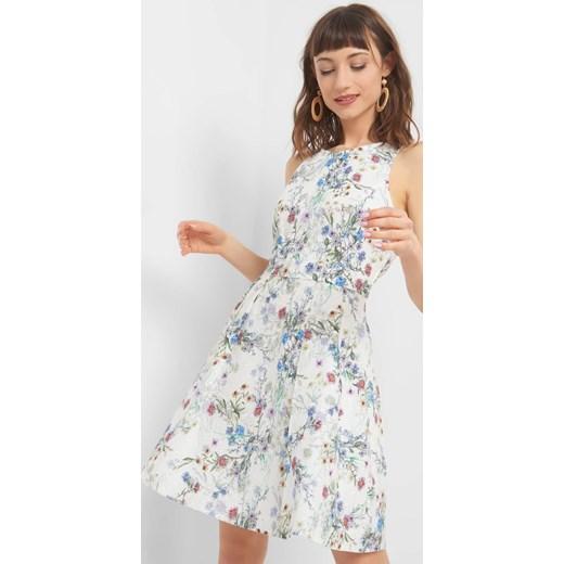 faf88f197a Sukienka ORSAY w stylu boho w kwiaty z tkaniny mini w Domodi