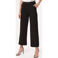 033d9b5ad64ddc Czarne spodnie damskie, lato 2019 w Domodi