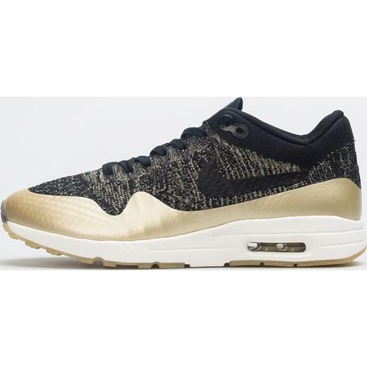 Nike buty sportowe damskie dla biegaczy na wiosnę czarne sznurowane na płaskiej podeszwie gładkie