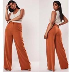 Spodnie damskie szerokie, modne kolekcje 2020 w Domodi