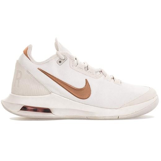 Buty sportowe damskie Nike do biegania wiązane beżowe płaskie bez wzorów
