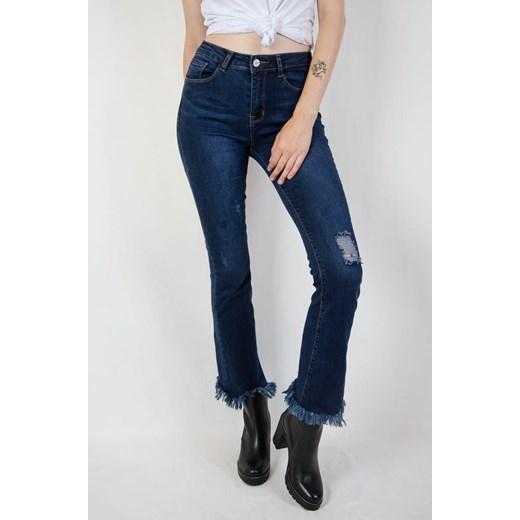 Ciemne spodnie jeansowe dzwony z poszarpaną nogawką olika