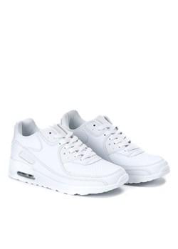 białe buty nike z czarnyk znakiem w kropki