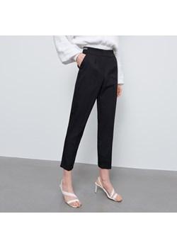 Czarne spodnie damskie, lato 2020 w Domodi